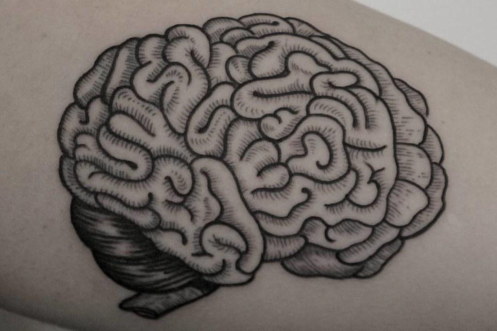 Super fun brain tattoo, bold lined with single needle deta