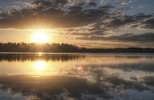 trees sunset sky sun lake nature water clouds landscape cloudy sweden stockholm horizon symmetry lensflare ripples sverige hdr sunbeams waterscape vallentuna vallentunasjön bällsta