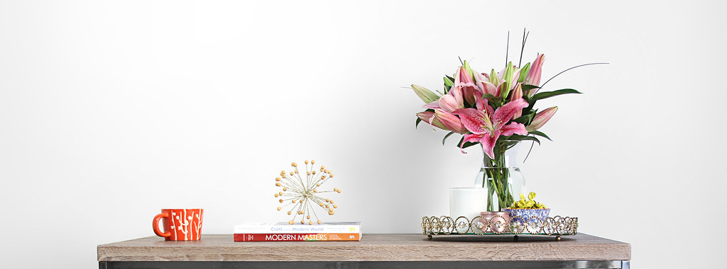 Coffee table with stargazer lilies