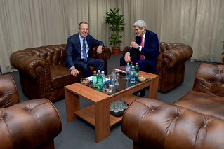Secretary Kerry Sits With Russian Foreign Minister Lavrov Before a Meeting in Belgrade