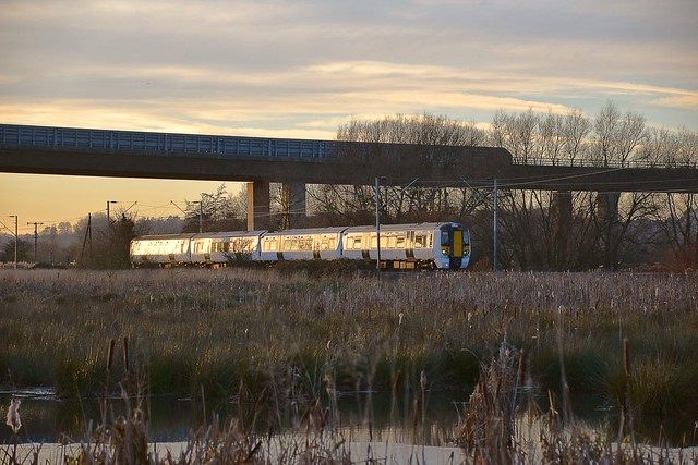 Electrostar 379 009 on the 15.09 departure from Hertford East - Broxbourne service, passing under the A10 Viaduct, on approach to Ware. 04 12 2016