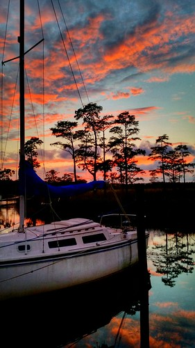 trees sunset sky reflection water clouds sailboat boats skyporn