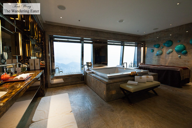 Enormous marble bathroom with an in-room spa bed