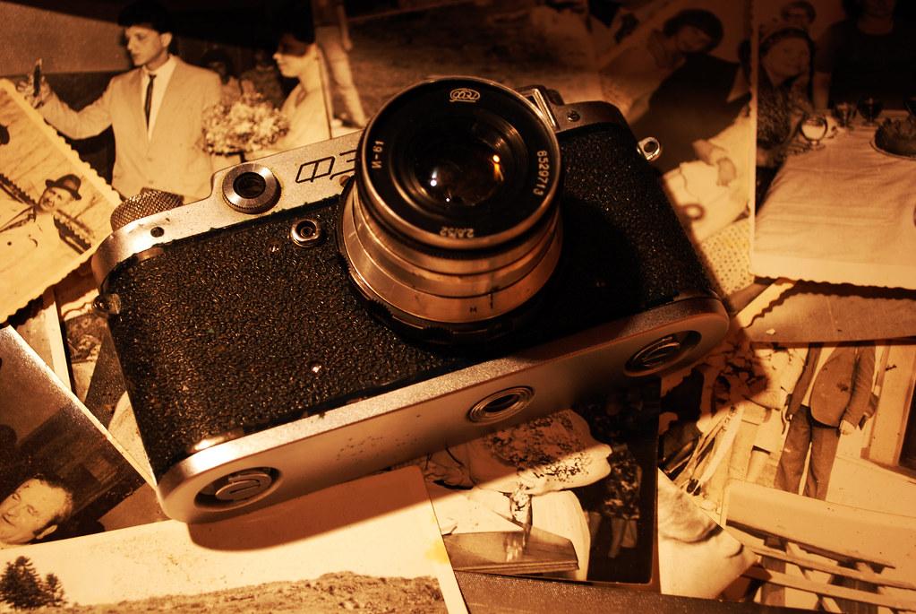Old Soviet Rangefinder Camera Fed 2 Placed on Top of Vintage Photographs
