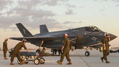 U.S. Marines with Marine Fighter Attack Squadron 121, 3rd Marine Aircraft Wing, conduct the first ever hot load of ordnance on the F-35B Lightning II, Sept. 22 in Yuma, Arizona. (USMC/Staff Sgt. Artur Shvartsberg)