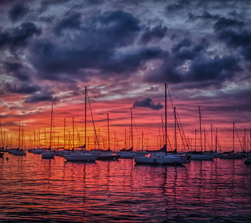 sunrise skyscape clouds cloudscape sailboats dusableharbor chicagoillinois cityofchicago cookcounty thewindycity downtownchicago chitown lakemichigan thegreatlakes summer july morninglight nautical orange red blue purple pink dawn newday landscape moorings mirrors reflections masts silhouettes colorful jazzy nikond5100 tamron18270 lightroom5 nature outdoors palette lakeshore marine maritime cabadil