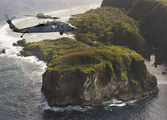 In this file photo, an MH-60S Sea Hawk helicopter assigned to HSC-25 operates off the coast of Guam. (U.S. Navy/MCC Joan E. Jennings)