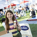 Enjoying some Di Rollo ice-cream | Little girl enjoys some Di Rollo ice-cream in the sun at the Book Festival © Helen Jones