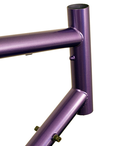 <p>Head tube on a Gunnar Sport in Starlight Purple.  The Sport makes a most comfortable road bike with medium wheelbase, relatively upright fit and capacity for bigger tires.  Note the long head tube extension makes for a comfortable fit while keeping the standover acceptably low.</p>