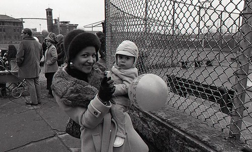 Woman holding a child at North End Christmas Party and Parade | by Boston City Archives
