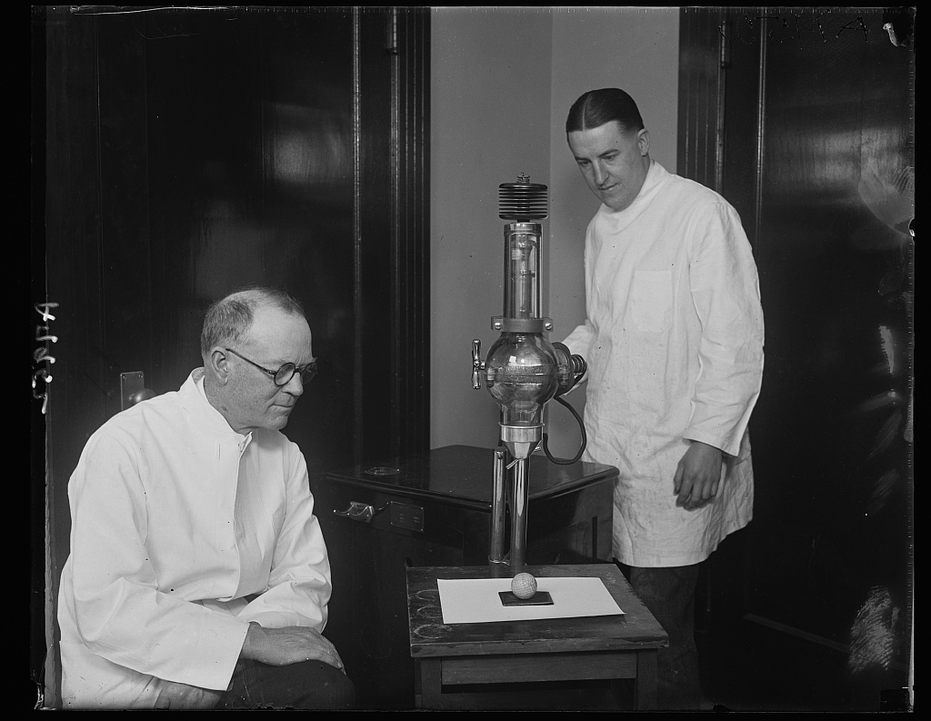 Identified! [[Dr. B.L. Taylor (left) and Dr. Walter A. Rath (right), dentists, using a dental x-ray to examine the cores of golf balls to see if they are centered] (LOC)