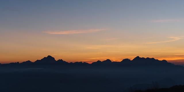 Dark mountain panorama silhouette at sunset