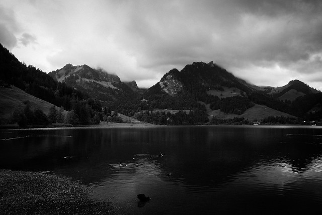 divers, mountains and dark water