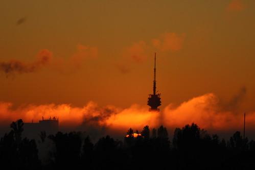 sunrise dawn shadow antenna tower fog
