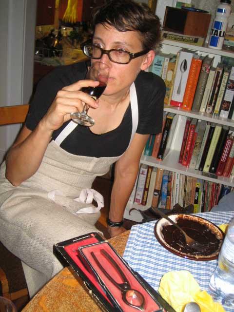 Sara sampling the vino (champagne tongs in foreground)