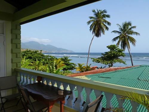 sea hotel coast view balcony palmtree caribbean guesthouse dominica calibishie nixonsbaysidemangroveinn