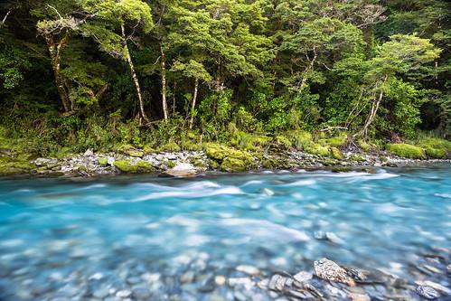 travel blue newzealand water landscape scenic unescoworldheritagesite southisland exploration naturallandmark bluepools mountaspiringnationalpark travelandtourism travelanddestination