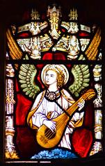 angel playing a mandolin (Clayton & Bell, 1880)
