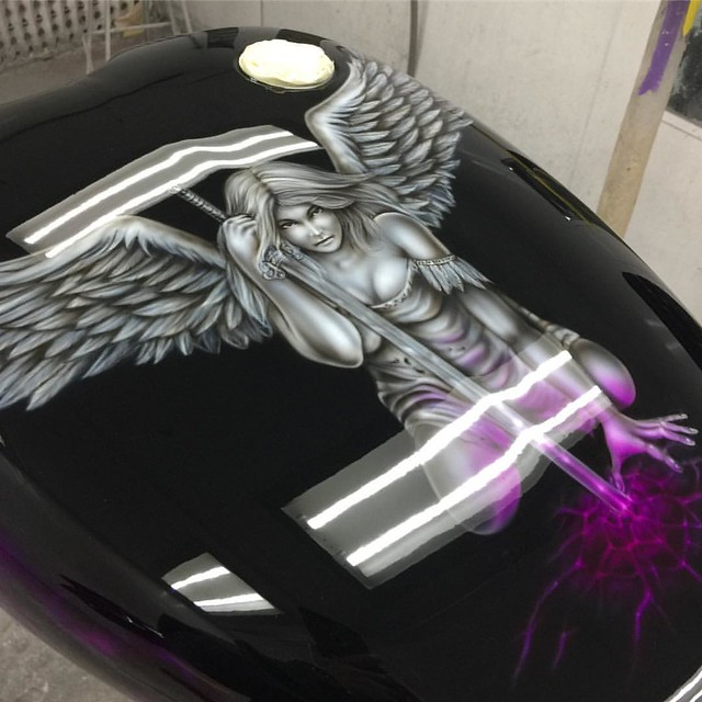 Angel mural on a harley tank, recently completed shown here before flowcoat, this is the same bike that we airbrushed the pink and violet realistic fire on. Pictures of the completed bike coming soon. #airbrush #airbrushart #angelart #angel #fantasyart #i