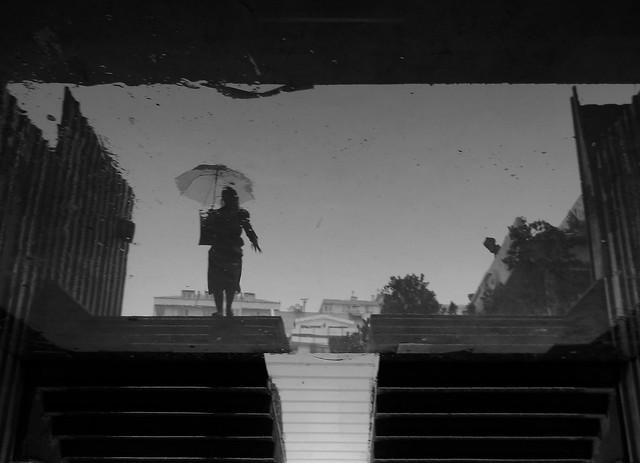 Rain woman reflection