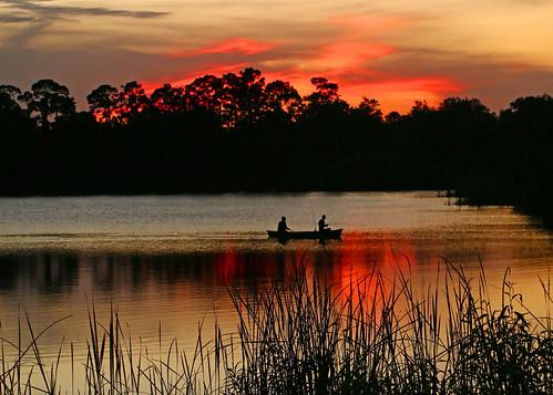 sunset boat fishing pond fishermen florida canoe fortpierce georgelestrangepreserve