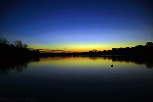 sunrise sun lake trees water