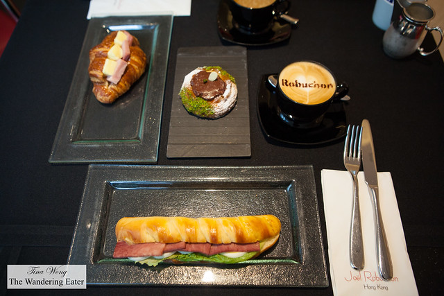 Ox tongue sandwich with hard boiled egg, chocolate danish, ham and cheese croissant and cappuccino
