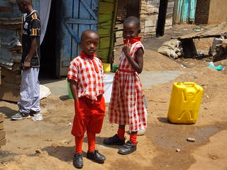 Siblings in new clothes, Kasubi, Kampala, Uganda