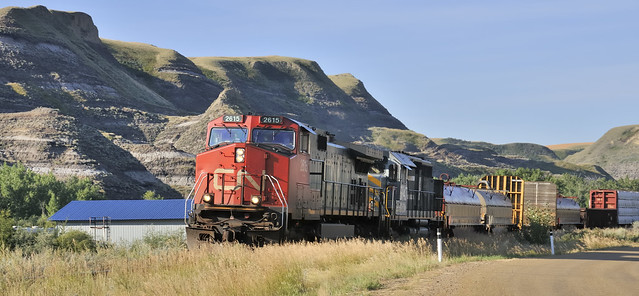 Canadian National mixed freight heading up Rosebud River Valley, Rosedale, Alberta..