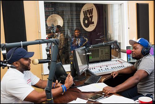 Abramson Sci Academy at WWOZ: band director Johnny Van Buren speaks with Derrick Freeman. Photo by Ryan Hodgson-Rigsbee www.rhrphoto.com