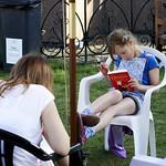 Girl reading in the sun | Enjoying a good book in the sun at the Book Festival © Helen Jones