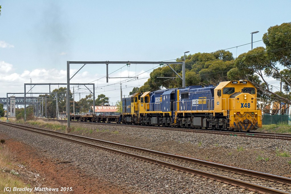 X48-XR555-H1 with 9201 down empty PN wagons transfer from Appleton Dock to Nth Geelong at Laverton (28/11/2015) by Bradley Matthews