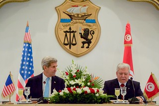 Secretary Kerry Listens to Foreign Minister Baccouche Speak after Signing Agreement at the Ministry of Foreign Affairs in Tunis