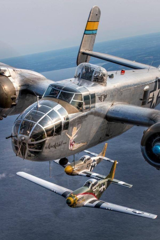 B-25 Mitchell with two P-51 Mustangs.B-25 Mitchell with two P-51 Mustangs.