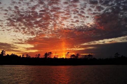 sunpillar lightpillar sunset cloudsstormssunsetssunrises clouds cloud water creek northwestcreek northcarolina fairfieldharbour fairfieldharbournc