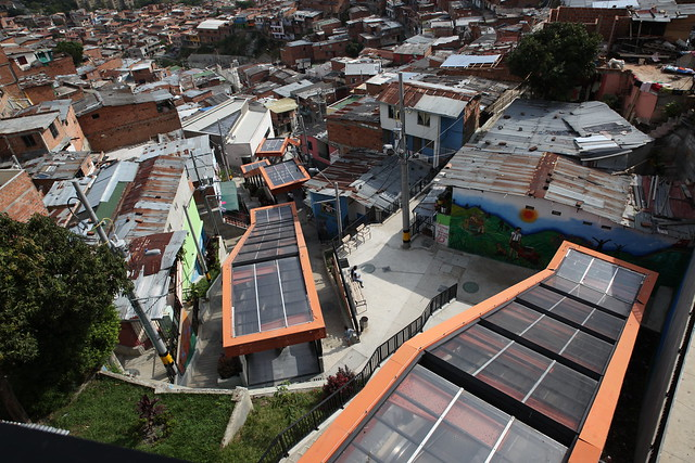 In the poor neighbourhood of Comuna 13, it's impossible not to miss one of Medellin's most controversial projects – the electric escalators.<br /> <br /> Launched in 2011, a series of free and covered escalators run through the slum, which have become a tourist attraction.<br /> <br /> It means around 12,000 residents now have a five-minute ride instead of a steep 350-step climb to reach their homes at the slum's upper reaches.<br /> <br /> But at a cost of $7 million and disconnected from the rest of the city's bus and metro network, some local residents say money would have been far better spent on job creation and building new homes and health clinics.<br /> <br /> On any given day, it appears there are more tourists riding the escalators than locals.