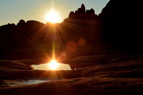 sunrise hueco water pool desert reflections canyonlands nationalpark utah backpacking fire sun