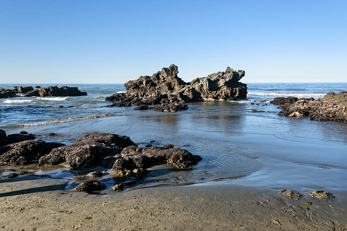 sea newzealand christchurch sky beach water spring sand rocks pacificocean sumner volcanicformation