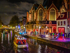 De Oude Kerk and Red Light District at Night - Amsterdam Netherlands