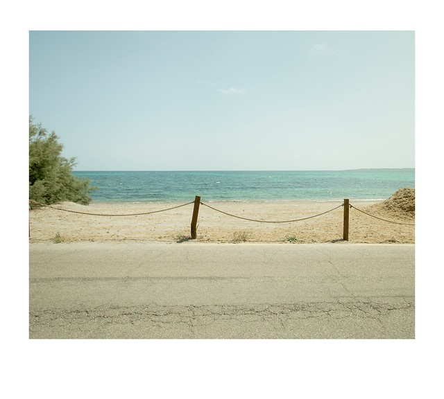 road, fence, distractions and sea.