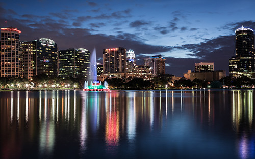 city longexposure sunset sky lake reflection fountain skyline clouds us orlando downtown cityscape unitedstates florida towers citylights bluehour lakeeola