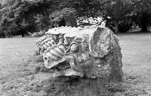 An image of four stone dragon heads outside Wallington Hall in Northumberland.