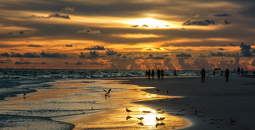 sanibel seashore afternoon sunset colors beachscape beach people walking waterways