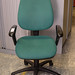 Green swivel chair with arms