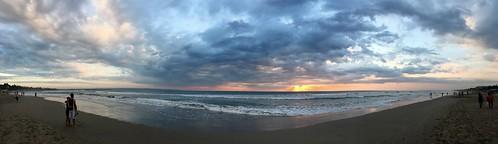 legian sunset beach ocean waves couple clouds