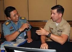 U.S. Navy Lt. Cmdr. Sam Wheeler discusses maritime operations with his counterpart Tentara Nasional Indonesia (TNI) Navy Capt. Edy Irawan during exercise Gema Bhakti. (U.S. Navy/Lt. Lenaya Rotklein)