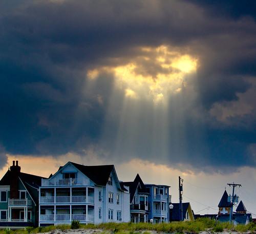 ocean sky beach clouds buildings landscape crepuscularrays sunsrays cano55250mmislens