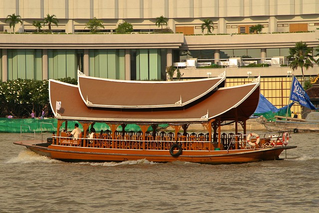 Shuttle boat for the River Shopping Complex in the evening sun on the Chao Phraya river in Bangkok, Thailand