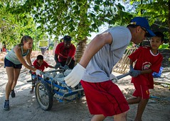 Sailors from USS Fort Worth (LCS 3) move rocks and soil while helping to complete construction of a retaining wall to prevent a nearby river from eroding the landscape at Home and Life Orphanage Foundation during a community service project. (U.S. Navy/MC2 Antonio Turretto Ramos)