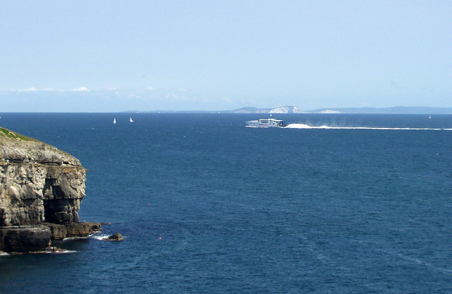 Condor ferry passing Tilly Whim Caves